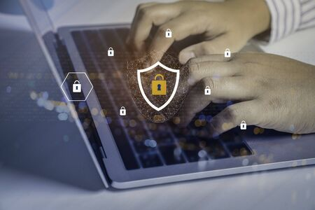 Businessman using a laptop computer with technology cyber security and privacy concept. protection and safe data for global network security.