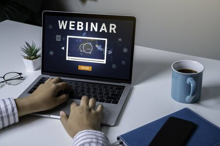 Person using a laptop computer for online training webinars. E-learning browsing connection and cloud online technology webcast concept. Laptop mockup