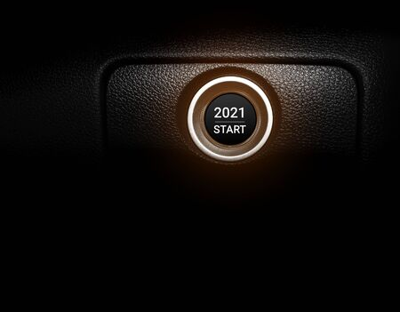 New year 2021 on car engine start button.