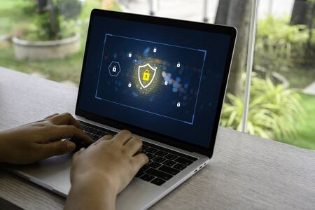 Person using a Laptop Computer with data protection, Cyber security, information safety and encryption concept. internet technology and business concept, Laptop mockup