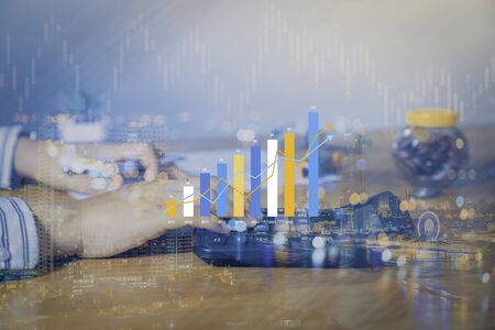 Double exposure of Money coin stack growing graph with bokeh light background,investment concept. plant growing on coin, business finance and save money concept. Stok Fotoğraf