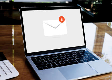 New email alert on laptop, Mail Communication Connection message to mailing contacts phone global letters in workplace.