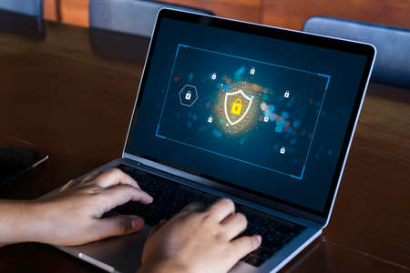 Businesswoman hand using laptop with Data protection, Cyber security secure, information safety and encryption concept. internet technology and business concept.