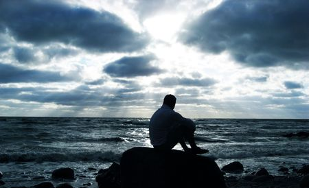 alone: Alone man thinking at the beach