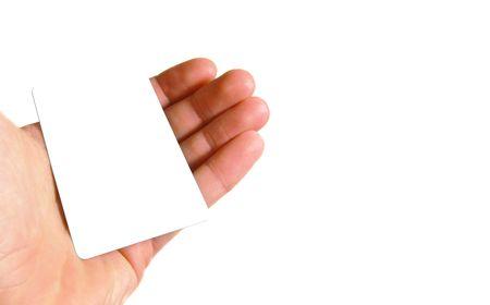 Hand holding blank card isolated on white background photo