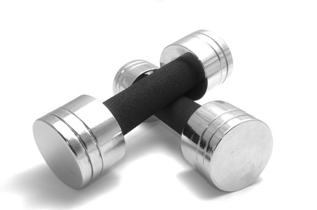 Two womens dumbbells on white background Stock Photo - 8665538