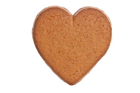 Brown ginger bread heart on white background. photo