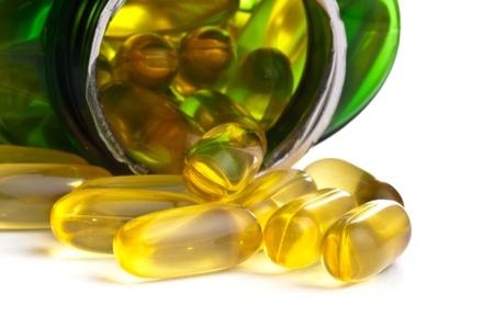 One bottle of omega 3 capsules over white background photo