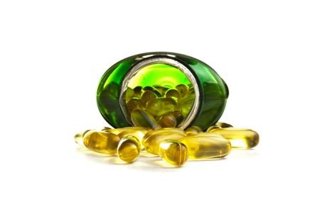 Omega 3 capsules in a bottle over white background Standard-Bild