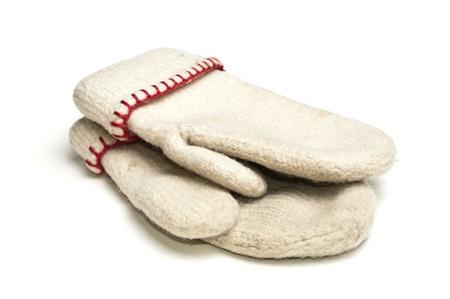 White mittens with red thread over white background Standard-Bild