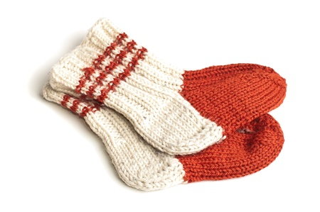 woll: Red and white knitted socks over white background Stock Photo