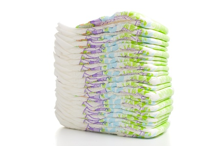 One stack of diapers over white background photo
