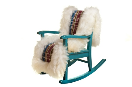 sheep skin: Antique rocking chair with woven sheep skin isolated on white Stock Photo