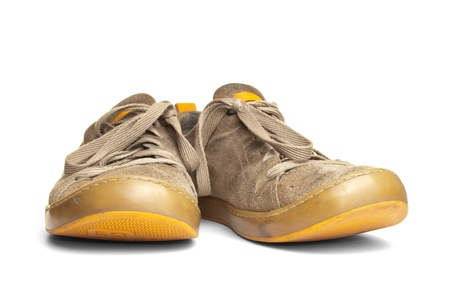 Old worn out suede shoes over white background photo