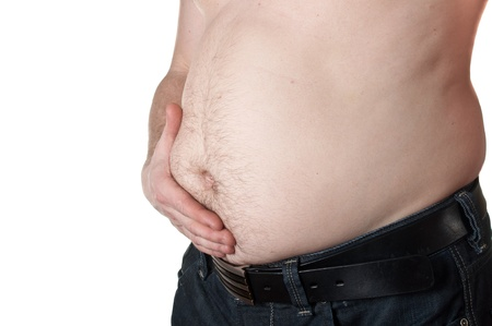 hairy male: One man holding stomach in with hand Stock Photo