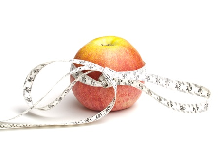 Red apple with white measuring tape over white background Stock Photo - 9349647