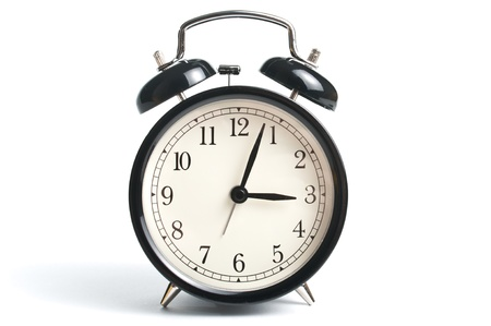 Alarm clock in black metal over white background