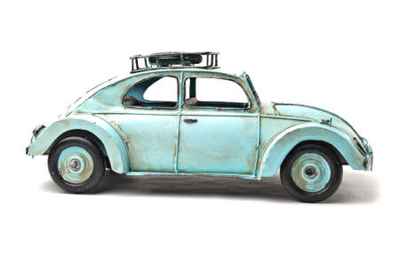 Old light blue toy car over white background