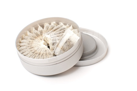 Chewing tobacco snuff in bags isolated over white