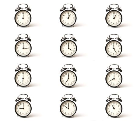 A set of alarm clocks showing every whole hour over white background with copy space Stock Photo