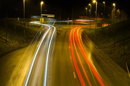 night traffic: Headlight and taillight trails at night in a roundabout