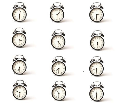 A set of alarm clocks showing every half hour over white background with copy space photo