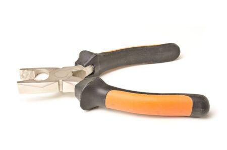 alicates: Alicates de acero y de plástico sobre fondo blanco con copia espacio Foto de archivo
