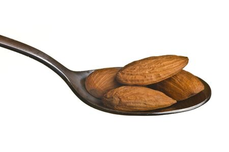 Almonds in a spoon isolated over white background Stock Photo - 11561482