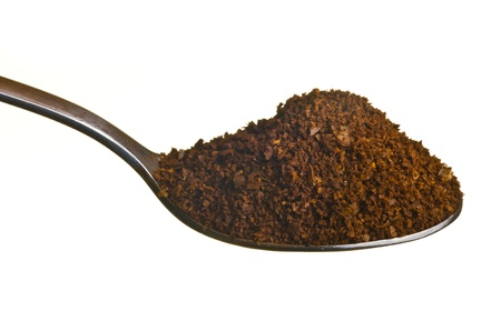 Coffee ground in a spoon isolated over white background Stock Photo - 11785879