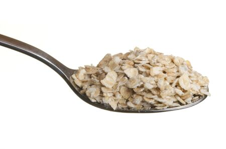Oatmeal in a spoon isolated over white background Stock Photo - 11785878