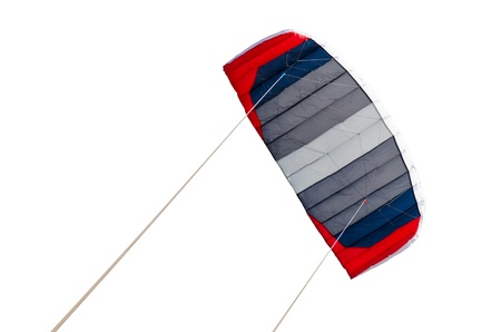 Red blue and grey flying kite isolated over white background photo