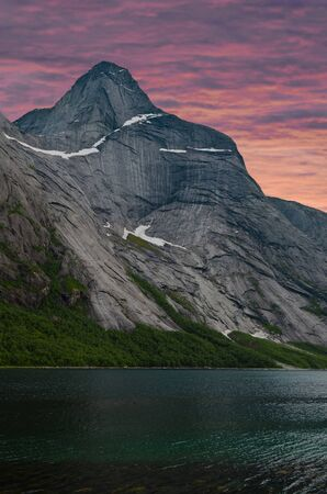 High peak and fjord at sunrise in northern Norway