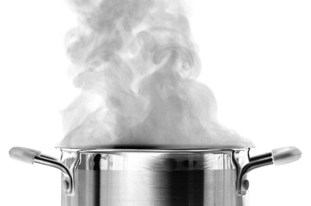 Boiling water in a saucepan over white background photo