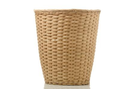 Wickerwork paper bin isoleted on white background photo
