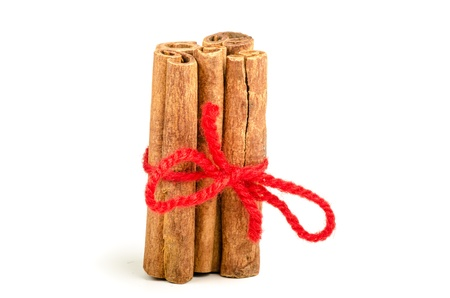 A bundle of cinnamon sticks over white background