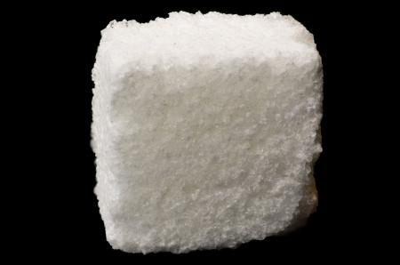 consumable: White sugar cube isolated on black background Stock Photo