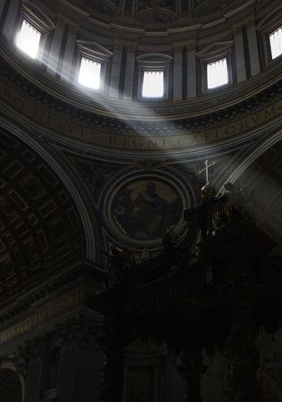 golden  gleam: Lightbeams falling through the windows of the dome of Saint Peters Basilica on the cross of the altar, Vatican, Rome, Italy, Europe