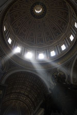 Lightbeams falling through the windows of the dome of Saint Peters Basilica on the cross of the altar, Vatican, Rome, Italy, Europe