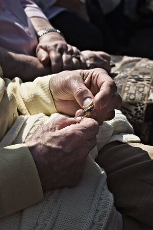 old hands with a rosary and a cross Stock Photo - 4807610