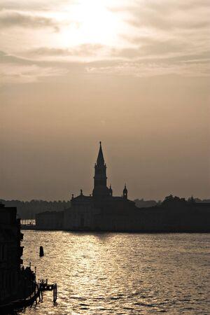 San Giorgio Maggiore as a silhouette in the golden morning light, Venice photo