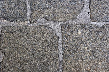 close up shot of cobblestones on the pavement photo