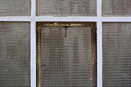 closeup shot of an old cellar window photo
