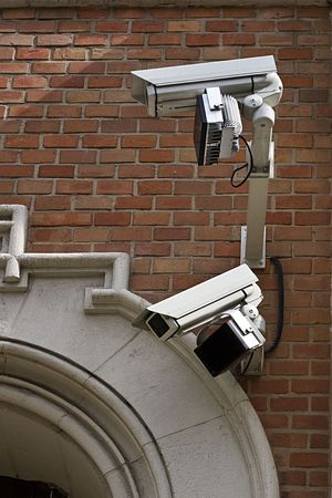 two monitoring cameras for surveillance on a wall photo
