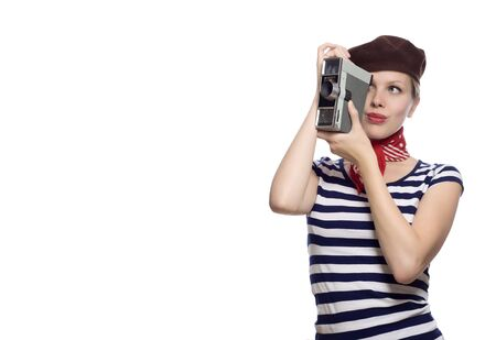beautiful girl with red bandana, beret and striped shirt in a classic 60s french look holding a vintage 8mm substandard camera Stock Photo - 5046566