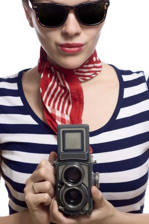 beautiful girl with red bandana, beret and striped shirt in a classic 60s french look holding a vintage twin lens medium format camera photo