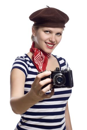 beautiful girl with red bandana, beret and striped shirt in a classic 60s french look holding an old photo camera photo