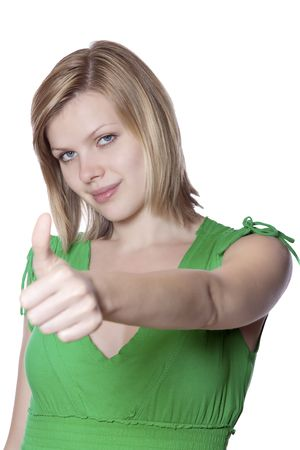 Joyful young woman in a green dress gives thumbs up Stock Photo - 5247598