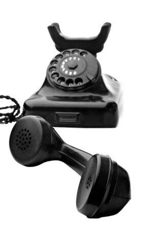 old vintage black rotary telephone isolated on white Stock Photo - 5252659