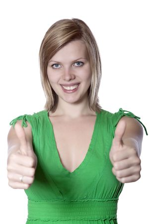 Joyful young woman in a green dress gives thumbs up photo