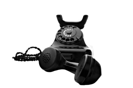 old vintage black rotary telephone isolated on white Stock Photo - 5254600